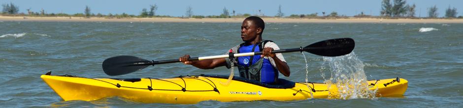 kayaking in sea in yellow kayak banner