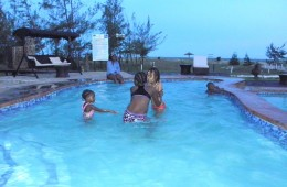 Children in the pool at dusk